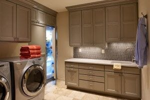 Luxury laundry room with concealed SubZero storage